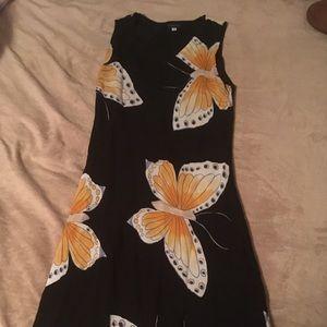 Black summer dress with yellow butterflies